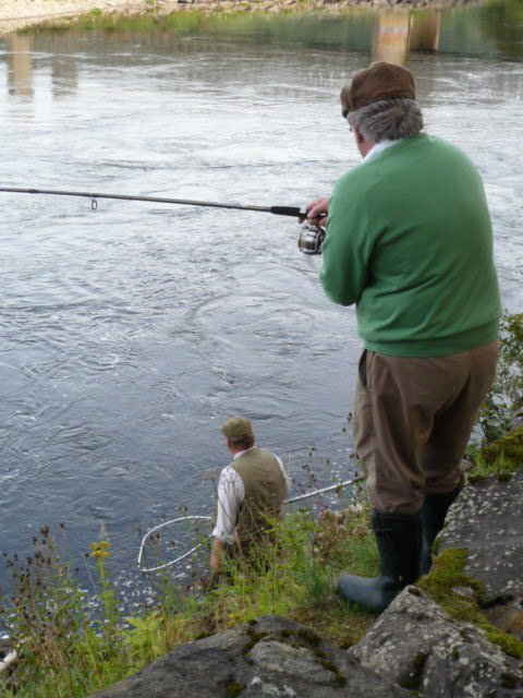 The fish is nearly at the net
