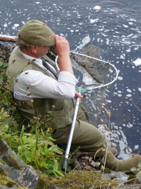 Stan has a quick snooze waiting to net fish