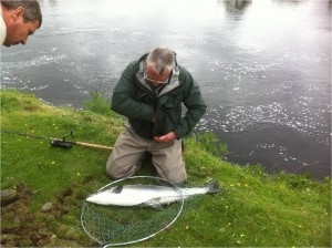 Donald with his 18lb Beautiful Silver sea-liced Salmon, hooked safely removed